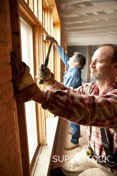 Stock Photo: 1589R-159046 Carpenters working on construction site