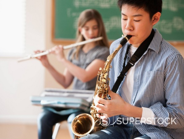 Students playing musical instruments : Stock Photo