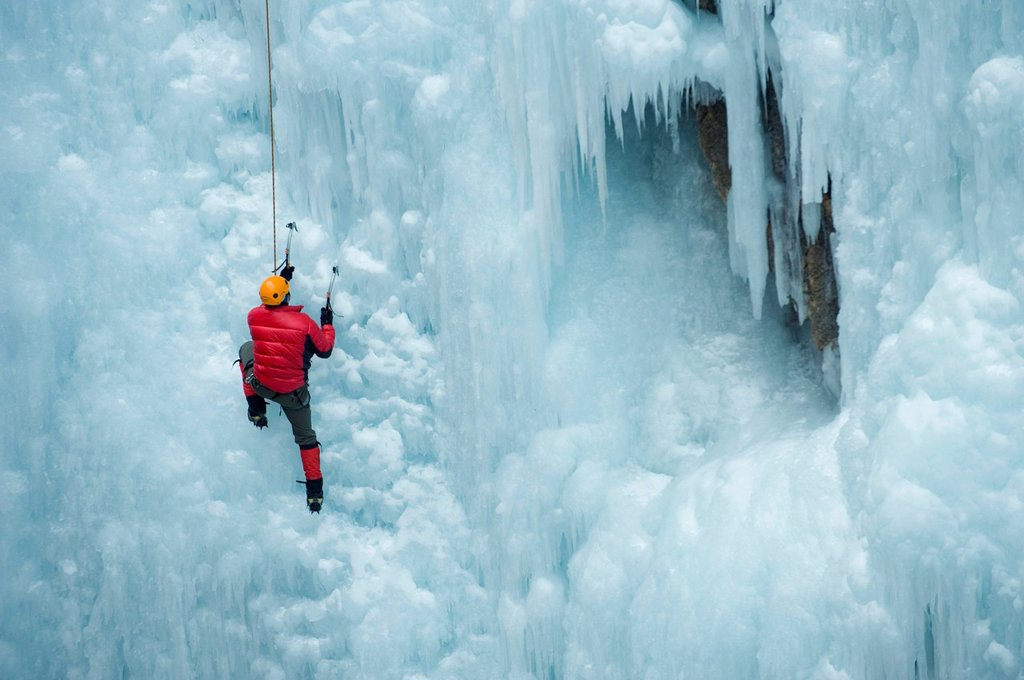 Stock Photo: 1589R-159922 Caucasian man climbing ice wall