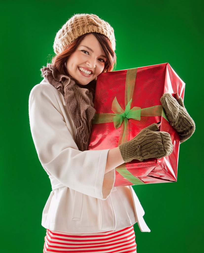 Stock Photo: 1589R-160046 Mixed race woman holding Christmas gift