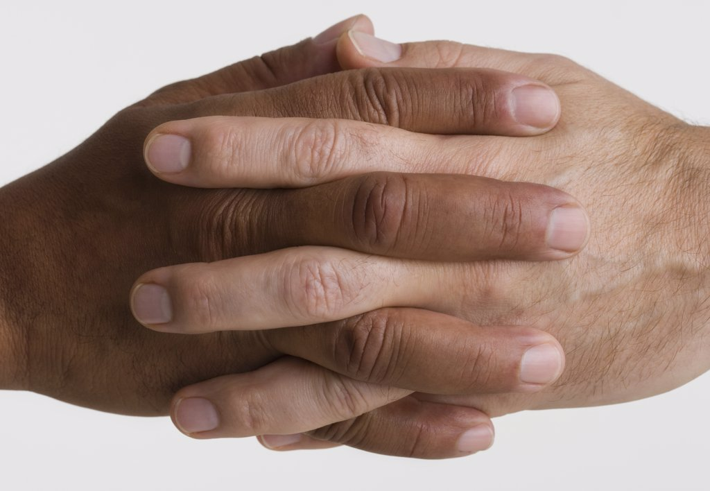 Stock Photo: 1589R-16013 Close up of two hands interlocking