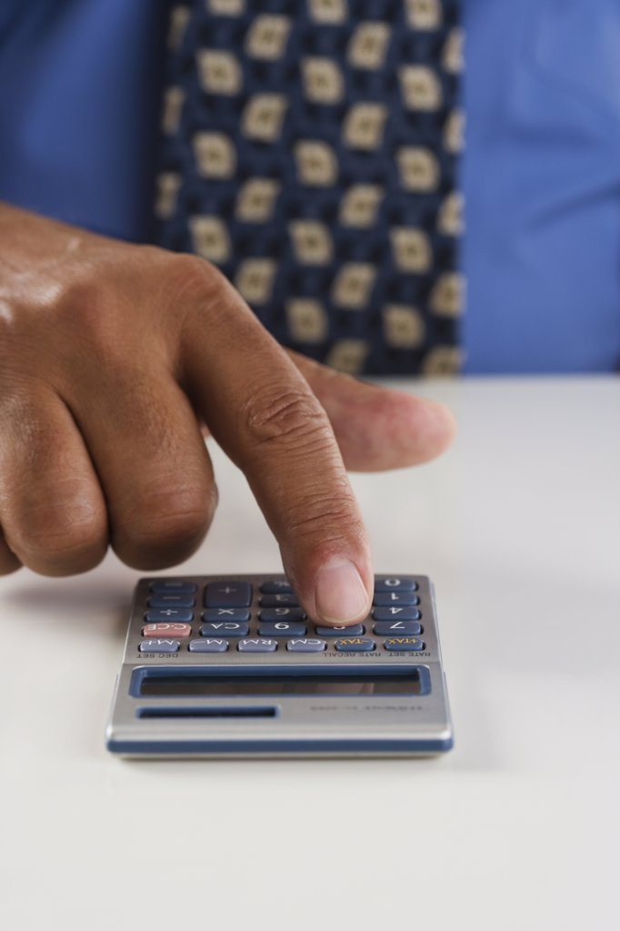 Stock Photo: 1589R-16036 Close up of businessmanís hand using calculator