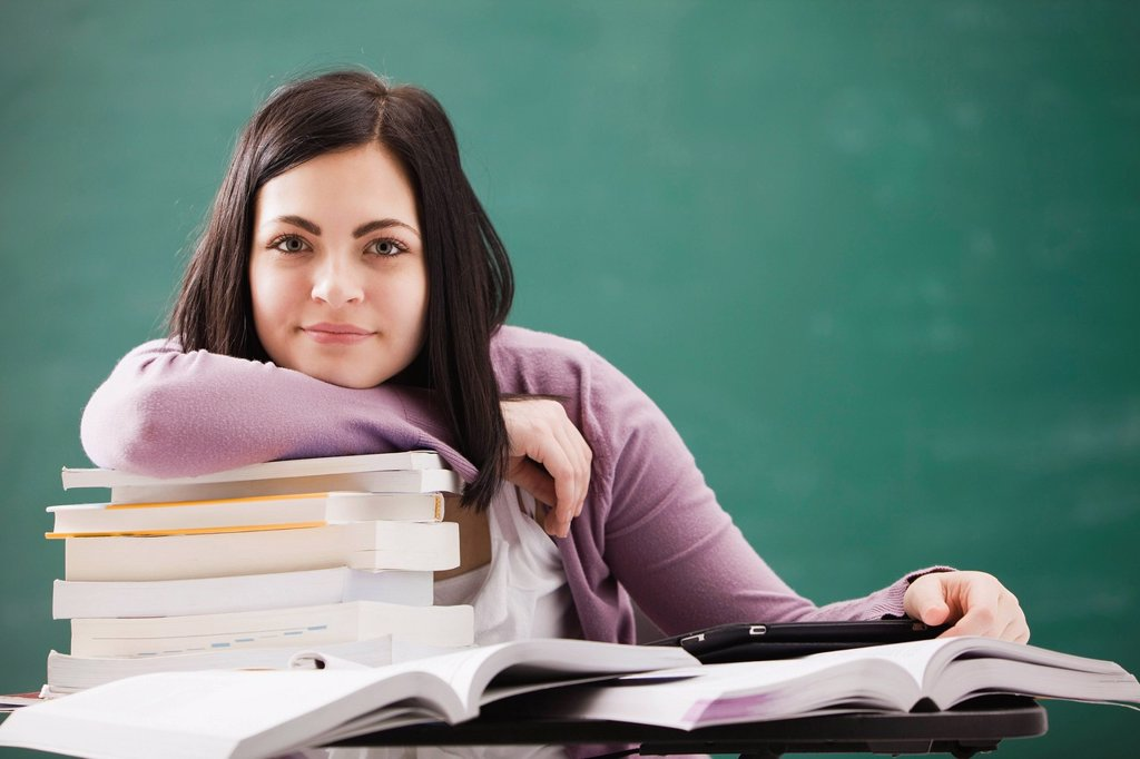 Stock Photo: 1589R-160462 Caucasian student doing homework