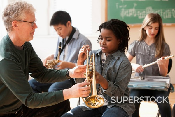 Stock Photo: 1589R-160576 Students preparing to play musical instruments