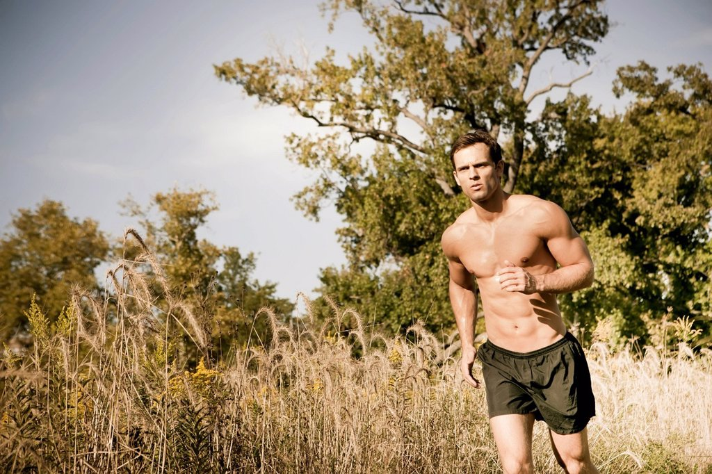 Stock Photo: 1589R-160662 Caucasian man running outdoors