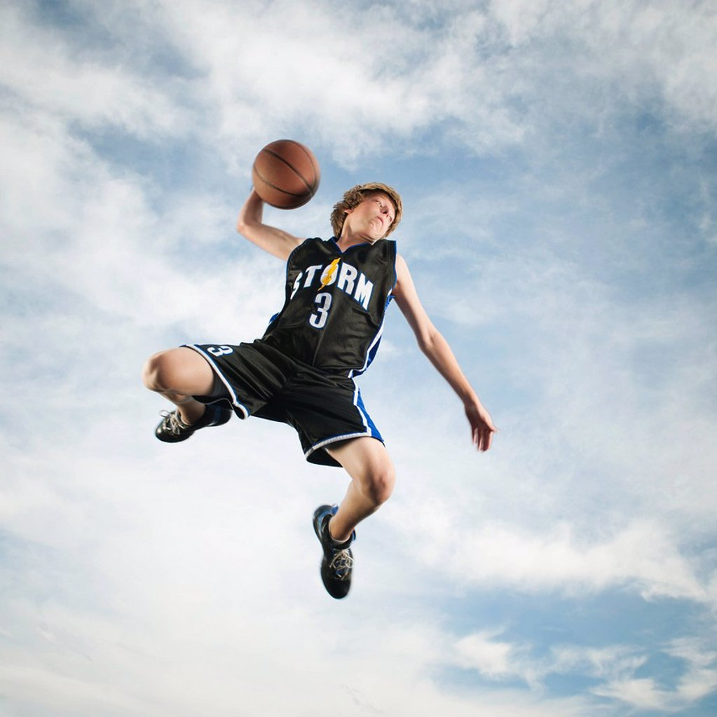 Stock Photo: 1589R-162556 Caucasian teenager playing basketball
