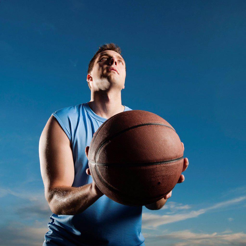 Caucasian man playing basketball : Stock Photo