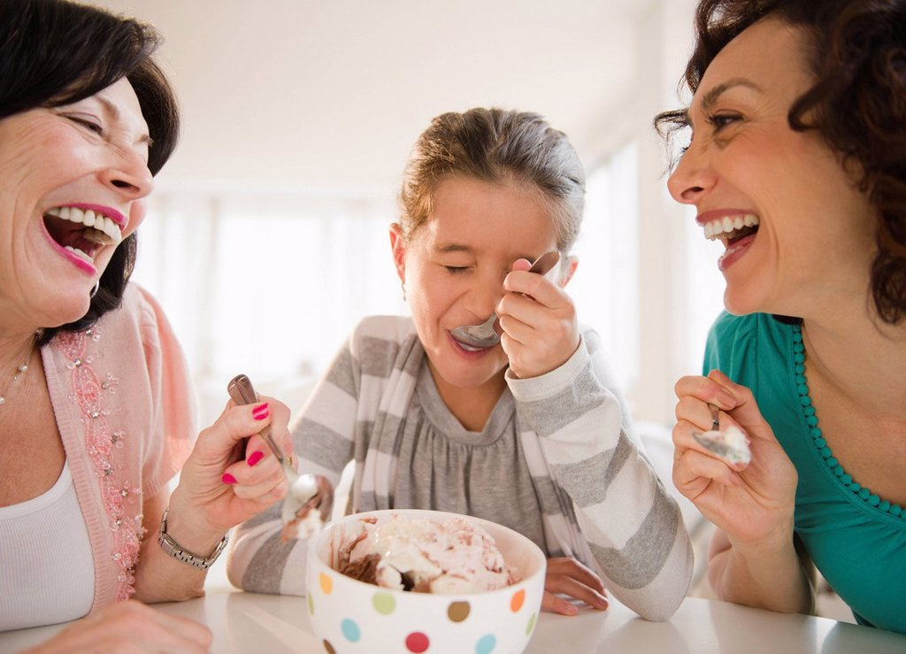 Family eating ice cream together : Stock Photo