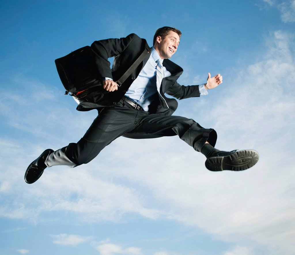 Stock Photo: 1589R-162813 Caucasian businessman jumping in air