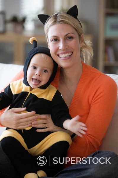 Stock Photo: 1589R-162877 Caucasian mother sitting with baby daughter in bee costume