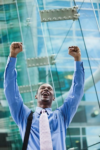 Stock Photo: 1589R-162903 Black businessman cheering outdoors