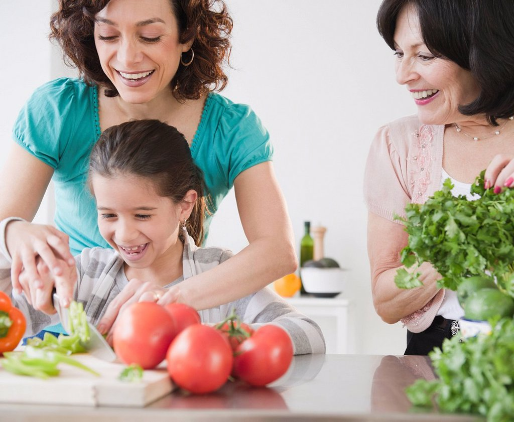 Stock Photo: 1589R-163002 Family cooking together