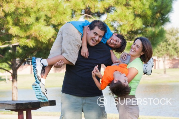 Stock Photo: 1589R-163017 Hispanic family playing in park