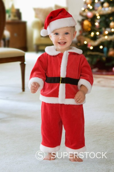 Caucasian baby girl in Santa suit : Stock Photo