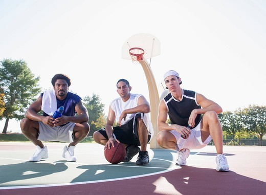 Stock Photo: 1589R-164344 Friends relaxing on basketball court