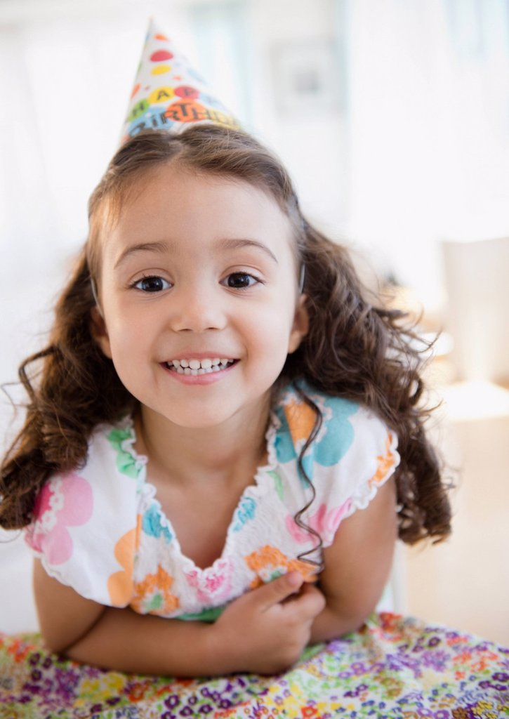 Stock Photo: 1589R-164861 Smiling mixed race girl in party hat
