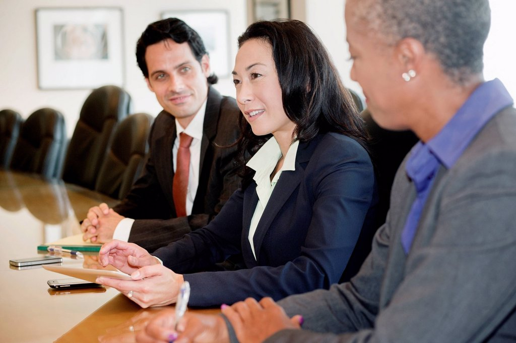 Businesspeople having meeting in conference room : Stock Photo
