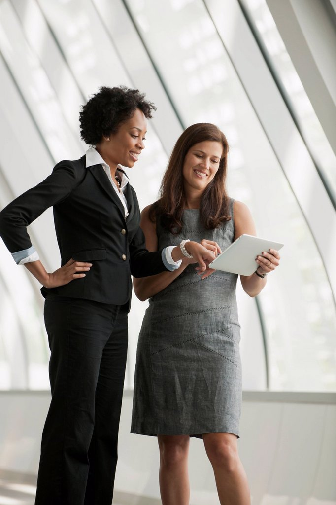Stock Photo: 1589R-166367 Businesswomen using digital tablet together