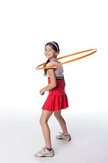 Caucasian girl playing with plastic hoop : Stock Photo