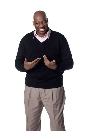 Smiling Black man making questioning gesture : Stock Photo