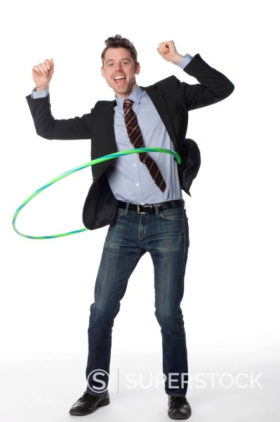 Stock Photo: 1589R-167284 Caucasian businessman twirling plastic hoop