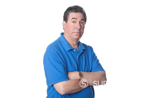 Stock Photo: 1589R-167463 Serious man with arms crossed