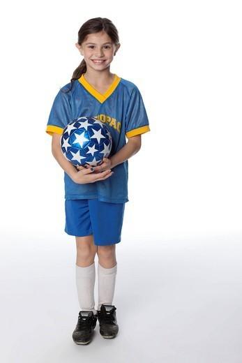 Caucasian girl holding soccer ball : Stock Photo
