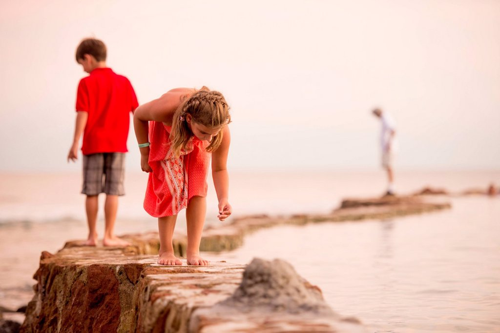 Children playing on jetty : Stock Photo