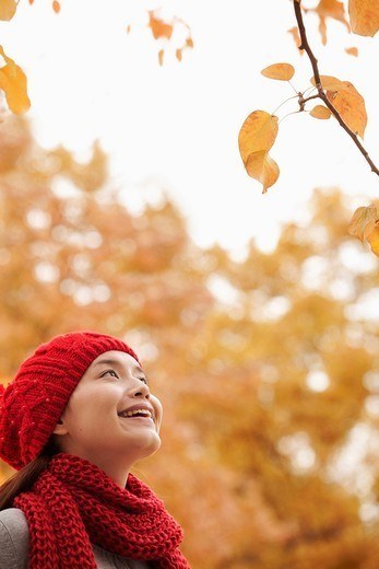 Stock Photo: 1589R-167920 Chinese woman looking at autumn leaves