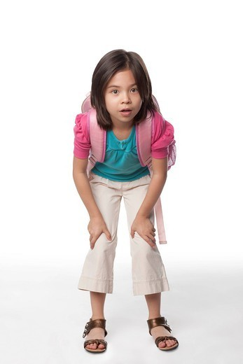 Mixed race girl leaning and carrying backpack : Stock Photo