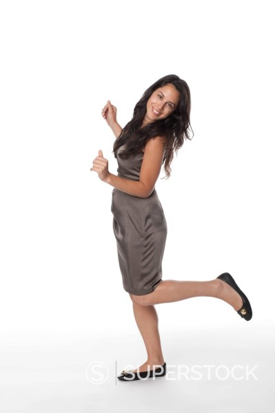 Stock Photo: 1589R-168200 Smiling mixed race woman standing on one leg