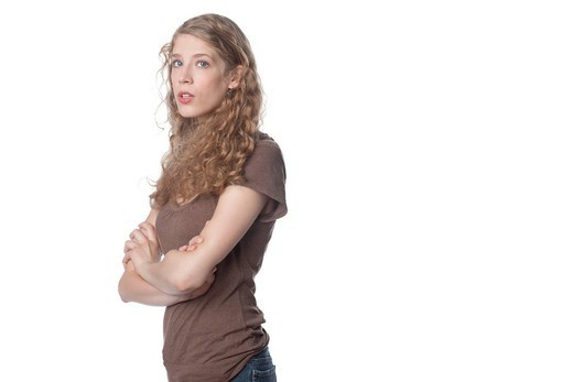 Serious Caucasian woman with arms crossed : Stock Photo