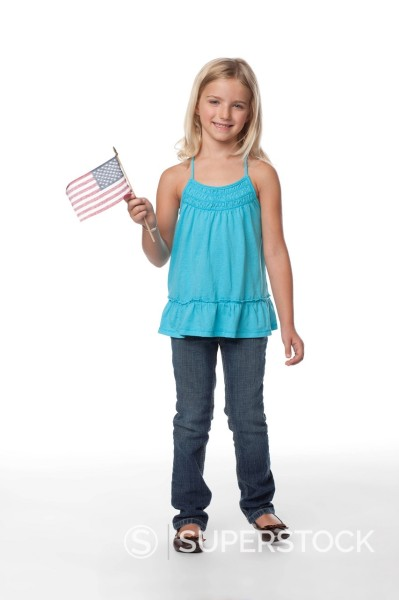 Caucasian girl holding American flag : Stock Photo