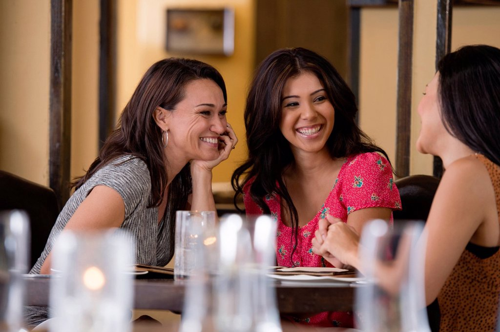 Stock Photo: 1589R-168346 Hispanic friends having dinner in restaurant