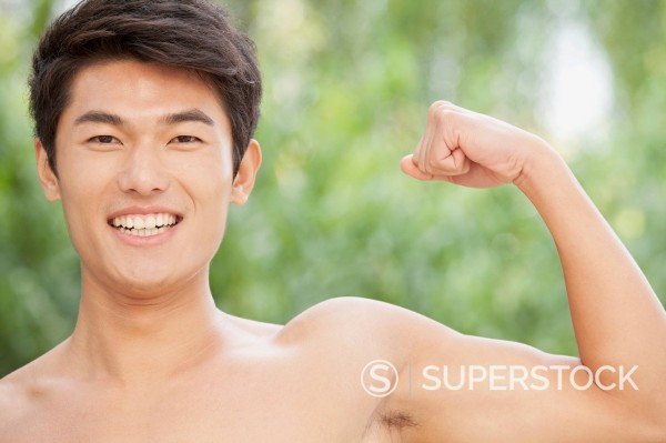 Stock Photo: 1589R-168366 Chinese man flexing muscles
