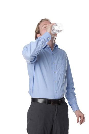 Caucasian man drinking water : Stock Photo