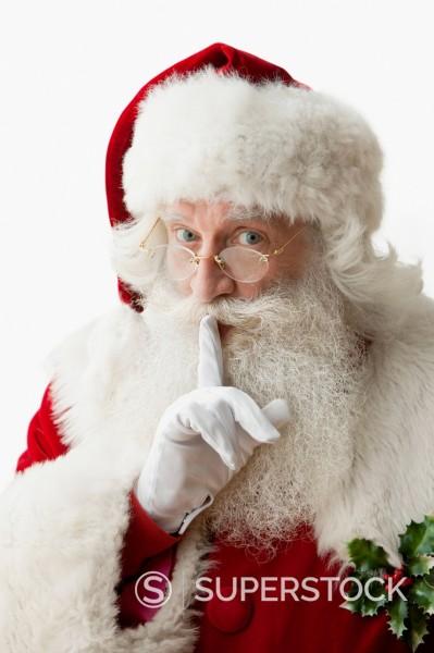 Stock Photo: 1589R-168777 Santa making shhh gesture