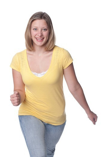 Smiling Caucasian teenager with arms outstretched : Stock Photo