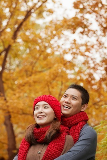 Stock Photo: 1589R-169107 Chinese couple enjoying autumn leaves