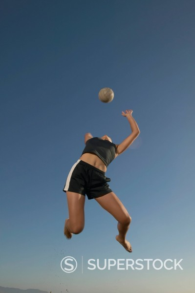 Stock Photo: 1589R-169434 Woman playing volleyball