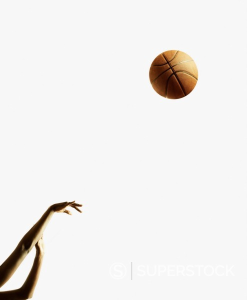 Stock Photo: 1589R-169477 Woman´s arms shooting basketball