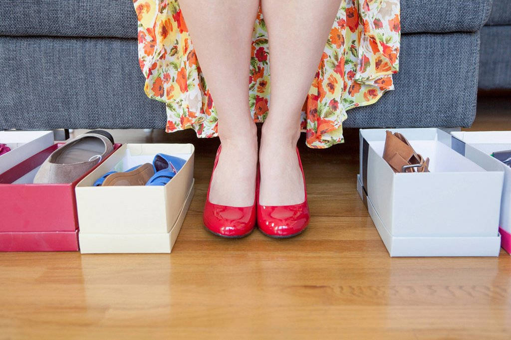 Woman´s feet with shoe boxes on floor : Stock Photo