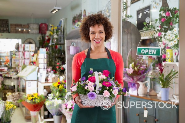 Stock Photo: 1589R-169513 Mixed race woman working in florist shop