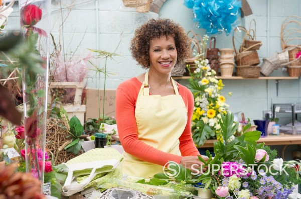Stock Photo: 1589R-169523 Mixed race woman working in florist shop