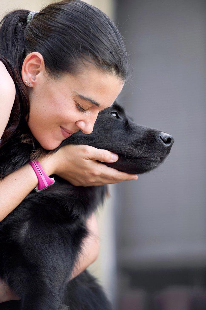 Stock Photo: 1589R-169593 Hispanic woman petting dog