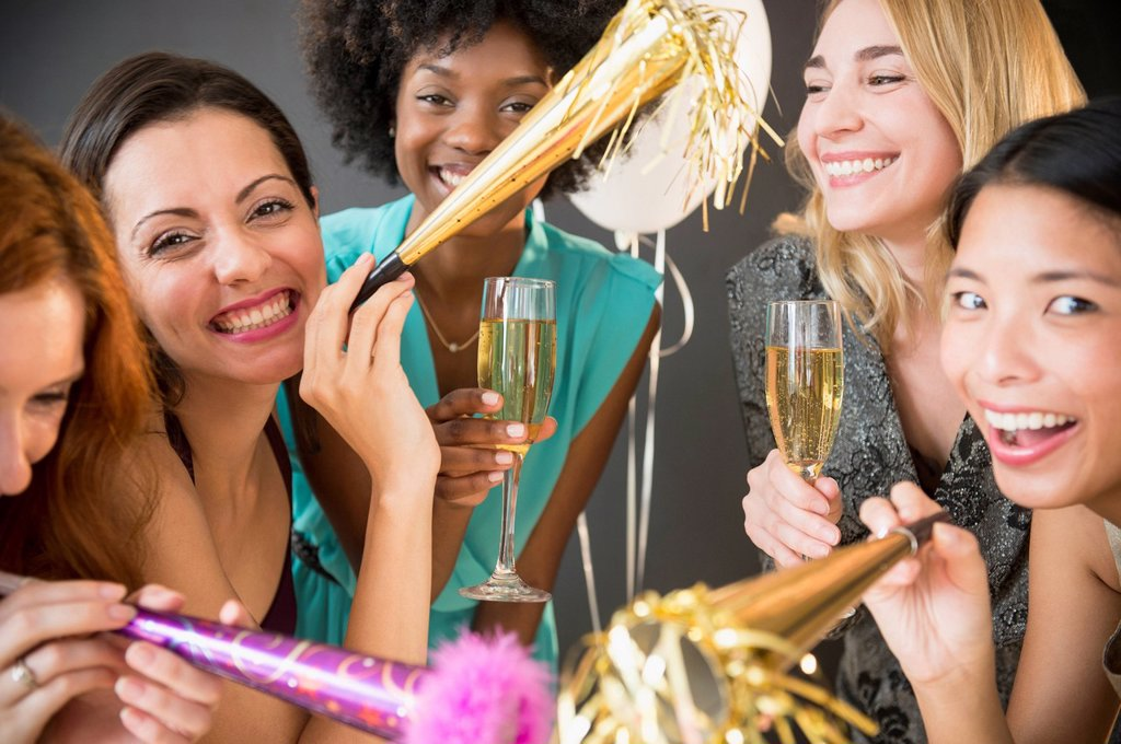 Stock Photo: 1589R-169717 Smiling women celebrating at party