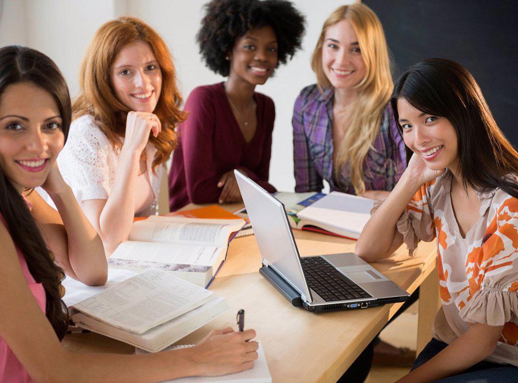 Businesswomen smiling in meeting : Stock Photo