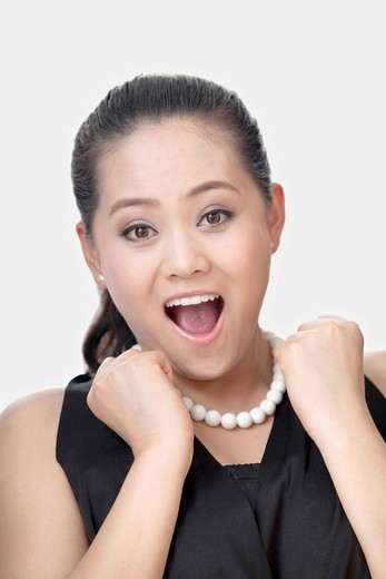 Excited Chinese woman : Stock Photo