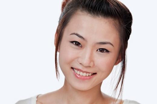 Smiling Asian woman : Stock Photo