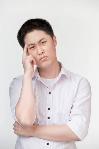 Uncertain Chinese man : Stock Photo